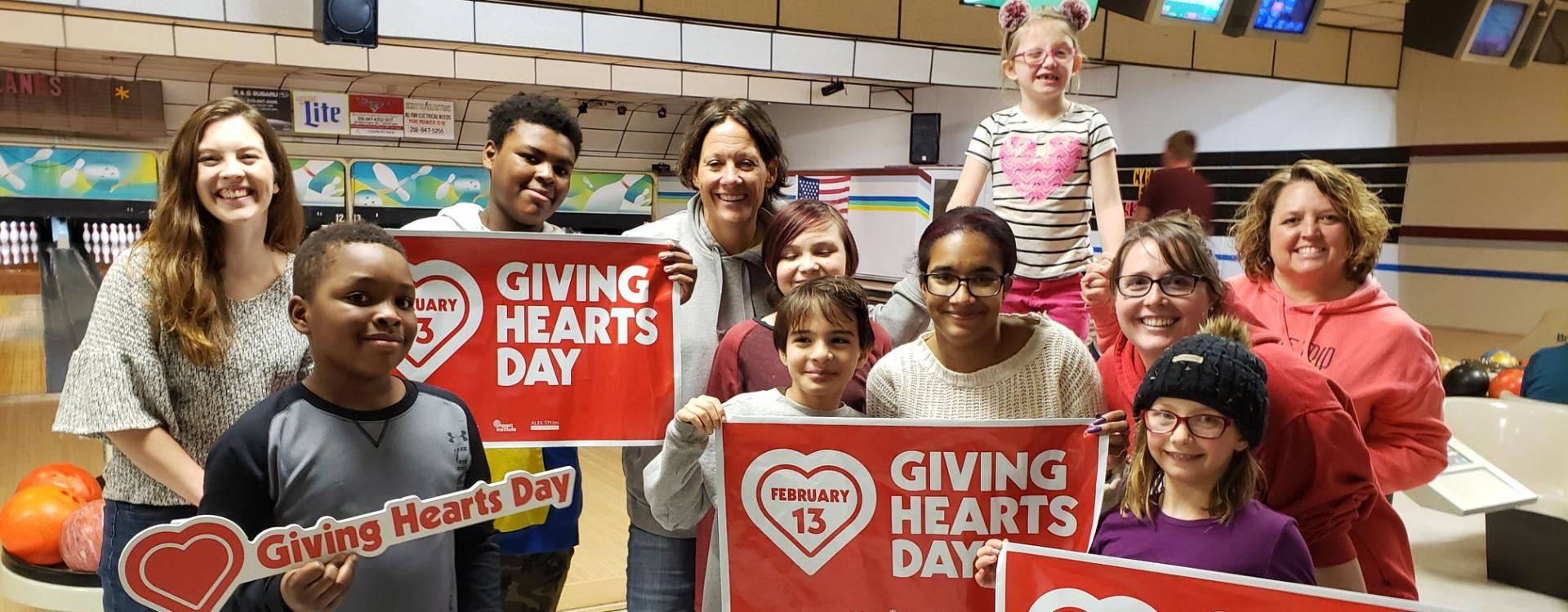 giving hearts day people at bowling alley